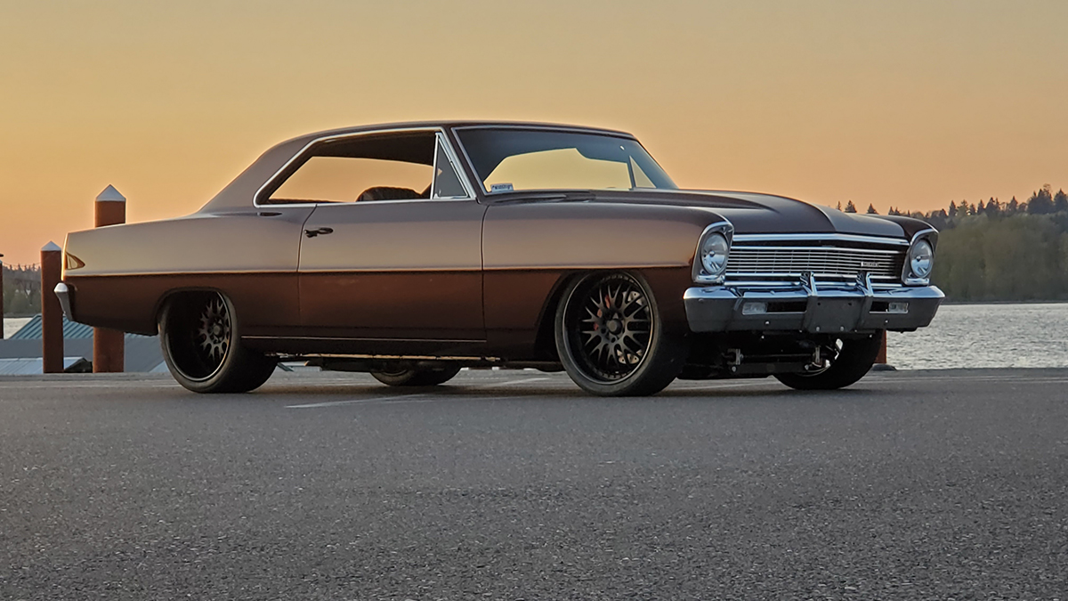 1966 Nova in front of a lake during sunset